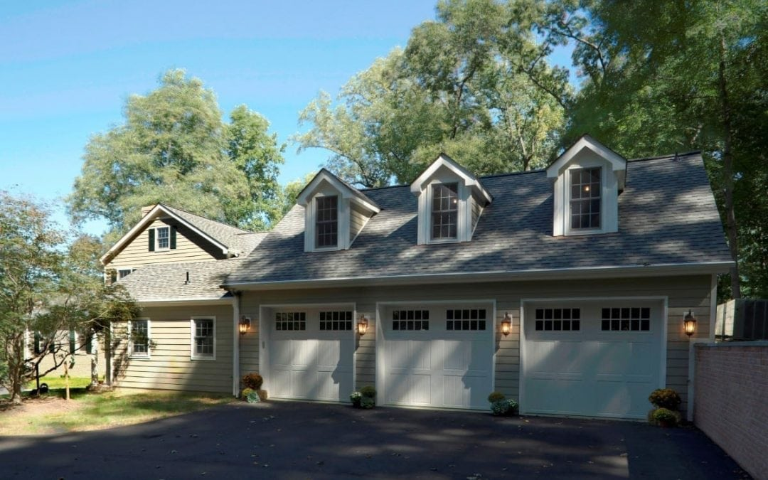 Elegant three car garage attached to home