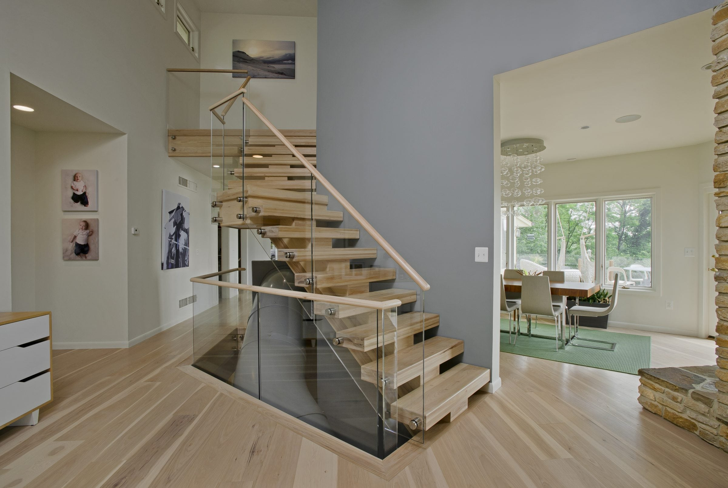 Contemporary floating staircase with glass railing