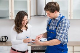 Woman smiling and talking with handyman