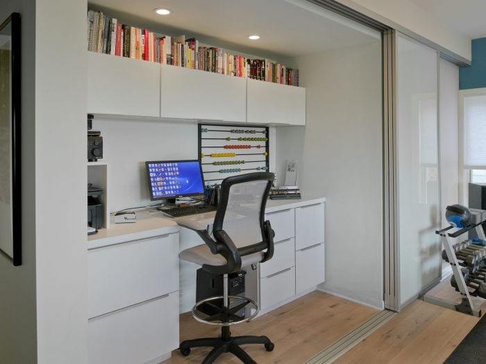 Disappearing contemporary home office by Owings Brothers Contracting