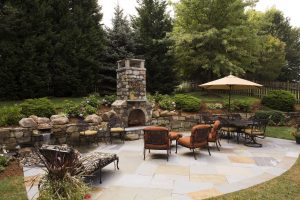 outdoor living patio with fireplace by owings brothers contracting