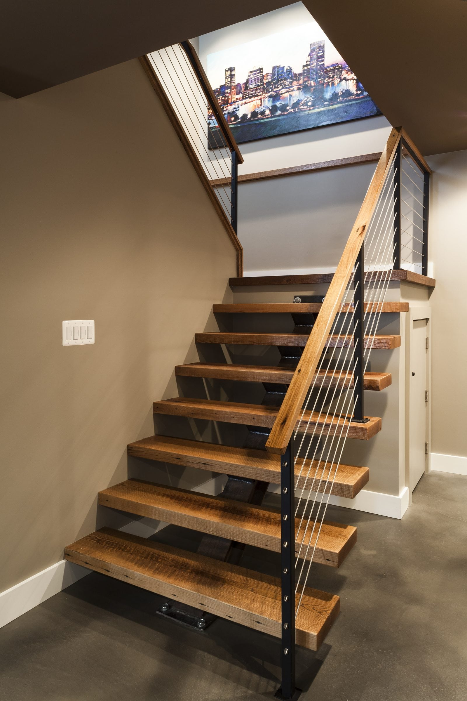 floating staircase with cable railings