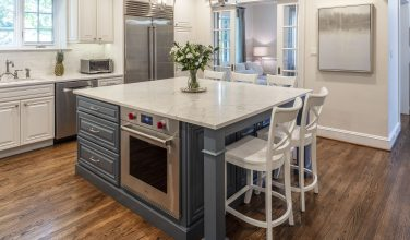 blue kitchen island with white countertop