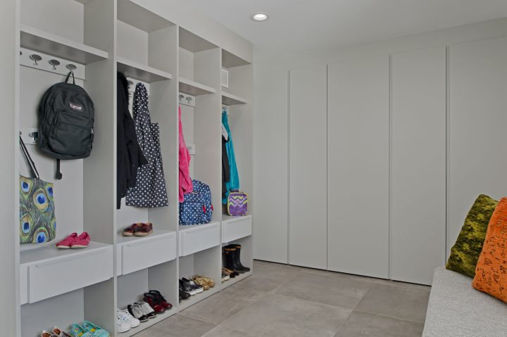 modern custom cubbies and press and close closets in mudroom