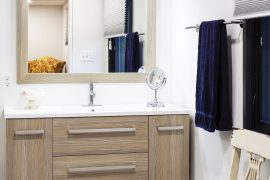 floating vanity in masterbath keeps floor clear and gives illusion of more space