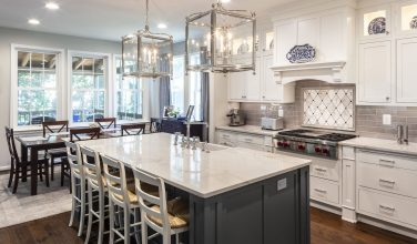 white painted kitchen cabinets with gray painted island